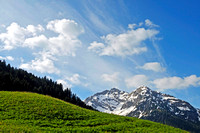 Mountain landscape with blue sky and green grass in Austria