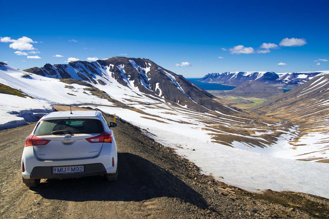 Car on a mountain pass in the Westfjords in Iceland