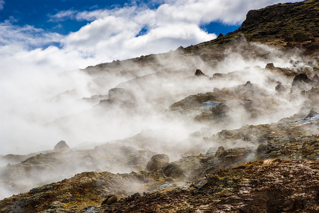 Steaming hot springs in geothermal area Krysuvik Iceland