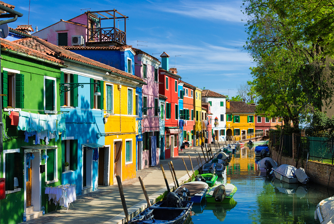 Colorful houses at the canal in Burano Venice Italy