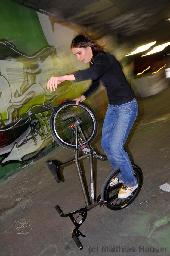Monika Hinz rides on her BMX Flatland bike, motion blur