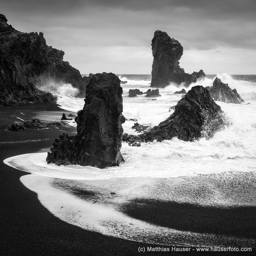 Dritvik beach with cliffs and crashing waves in Iceland