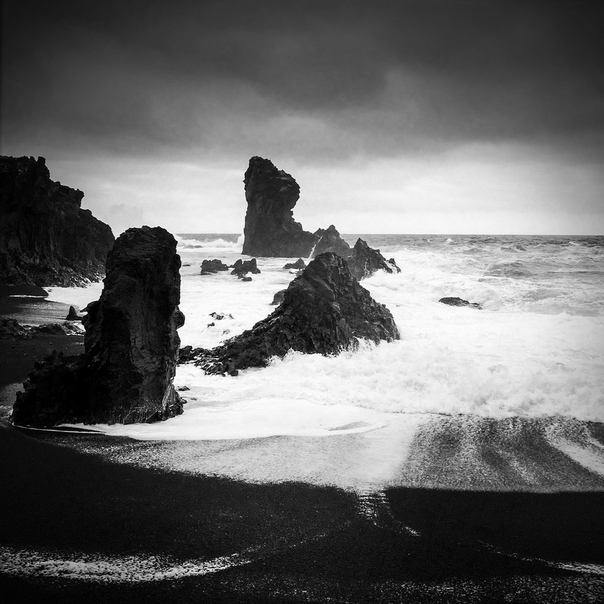 Dritvik coast Iceland ocean and rocks and black beach