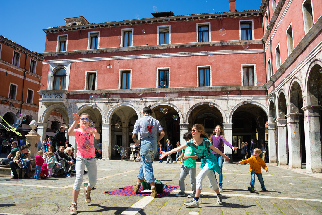 Kids playing with bubbles at Campo San Giacomo di Rialto in Venice