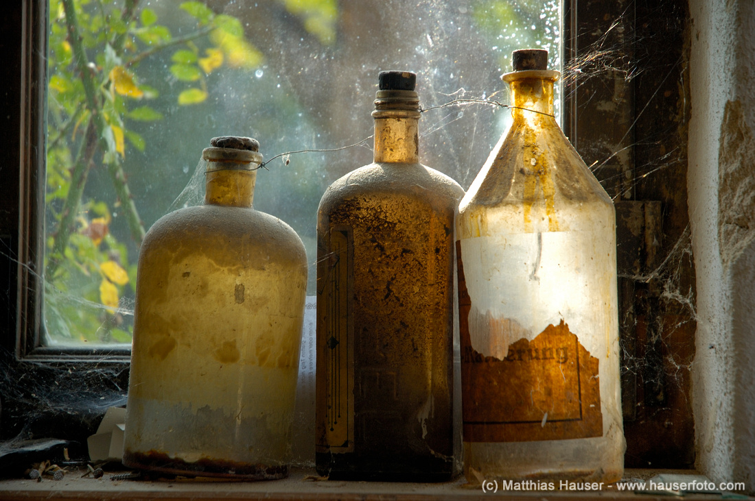 Nostalgia - three dusty old glass bottles