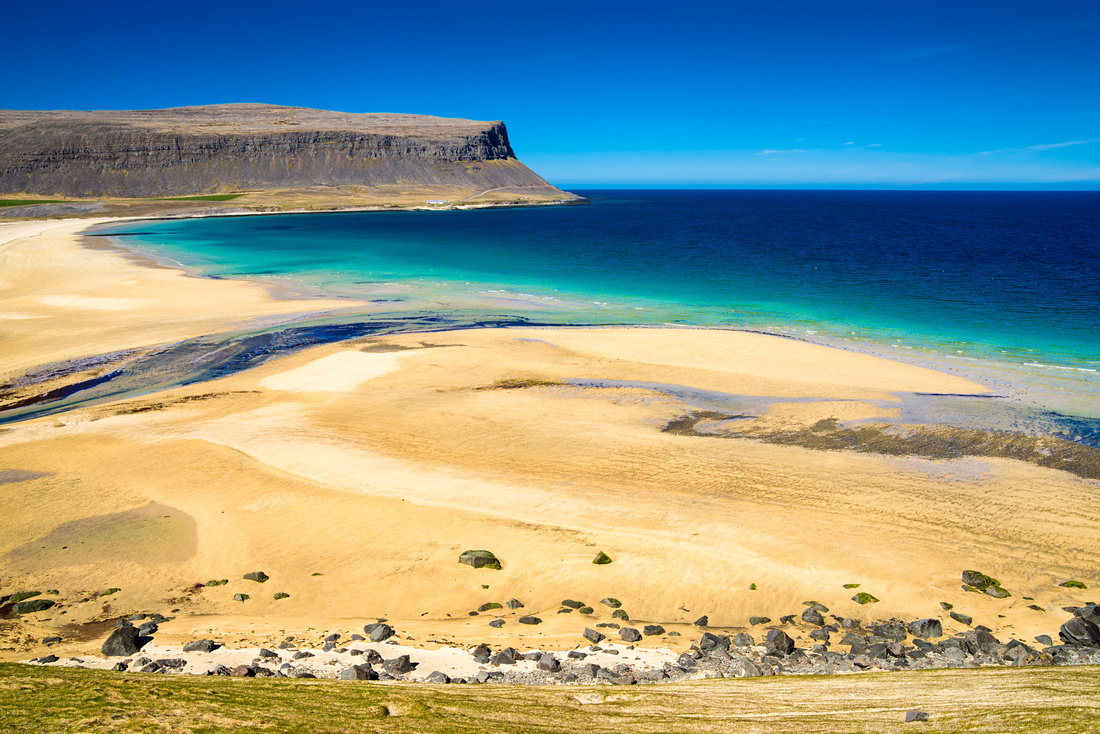 Beach and ocean in the west fjords in Iceland Europe
